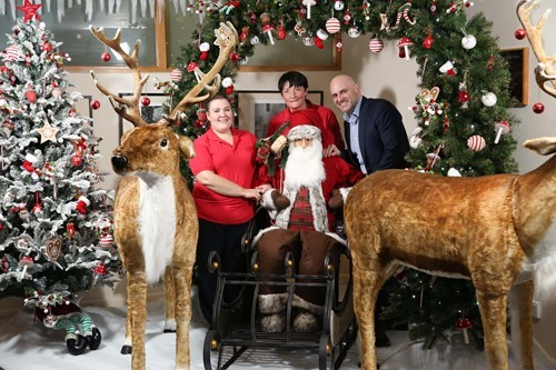 VANRATH founder and Director Wayne Sullivan and NI Hospice staff nurses Grainne Donnelly and Janet Burns (right) welcome the festive wonderland created by VANRATH and Blue Moon Event Design as a gift to Northern Ireland Children's Hospice